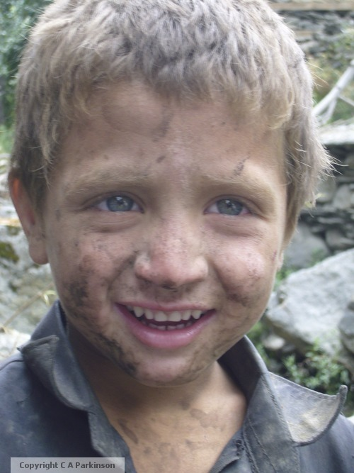 Blue-eyed-Kalash-child